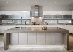 Love this! High Gloss with Back painted Camel Metalic Glass Doors under the 100mm Mocha Caesarstone island