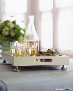 DIY Tray Chic~ Simple drawer pulls become fancy feet for a plain wooden tray and make it worthy of special occasions. Prime and paint tray. SO PRETTY!