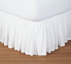 I like this one b/c it's feminine AND hard to detect wrinkles  :)  Voile Bed Skirt #potterybarn