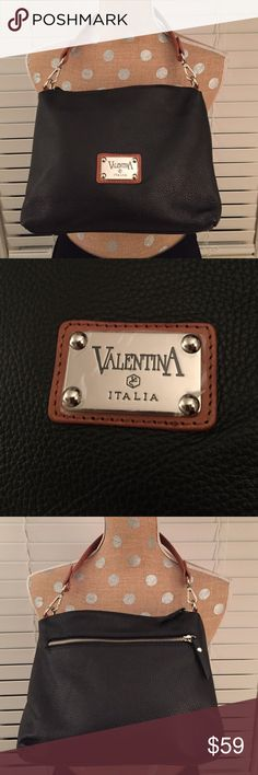Valentina Italia✨Pebbled Italian Leather Bag NWOT✨Excellent condition black, soft leather bag. Film still on hardware. See pic 2. Has an outside zipper pouch, inside 2 open pouches and one zipper pouch. Clean inside and out! Valentina Bags Shoulder Bags
