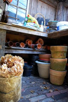 outdoor storage for gardening pots; repotting ... being #restoredinnature {Inside The Potting Shed by Steenbergs, via Flickr}