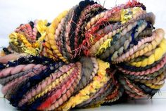 Knitting with this Hand Spun Art Yarn called Coral Gold Whispers from KittyGrrlz and it is beautiful!