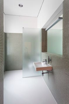 An Opaque Glassenclosed Shower Is Adjacent To A Long Taupe Vanity - Bathroom partition glass