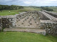 Granary at Vercovicium. The pillars supported a raised floor to keep food dry and free from vermin (James Crow (2004), Housesteads. A Fort And Garrison on Hadrian's Wall, Stroud: Tempus, p. 56.) They are not part of a hypocaust.