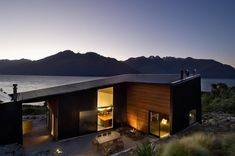 Architecture: Drift Bay House By Kerr Ritchie Dramatic Mountainscape Family Lake House Wooden Wall Wooden Outdoor Seat Exterior House Design. Architecture Design, New Zealand Architecture, Beautiful Architecture, Modern Family House, Modern Lake House, Style At Home, Studios, Cool House Designs, Home Fashion
