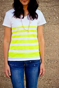 I love stripes and bright colors, so I made this t-shirt using spray  paint... yeah who would have thought you can spray paint on clothing... I  mean, on purpose. I'm sure we have all done it on accident! first. Get a  t-shirt, fluorescent spray paint and some painter's tape.  second. Tape off your lines. I also used some paper (you can use newspaper  or freezer paper, just any type of paper) to cover the top and the bottom  of the t-shirt. You want to make sure that you cover any part of…