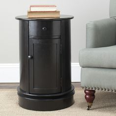 The Tabitha oval cabinet features a versatile appeal canNt be denied. With its simple styling in vintage grey finish, Tabitha will fit right into country-style or traditional homes.