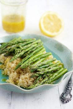 A fresh quinoa and asparagus dish that's perfect for springtime! This healthy dish is finished with a flavorful lemon mustard vinaigrette.