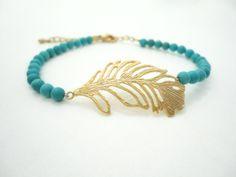 Turquoise Bracelet Friendship Bracelet Beaded Bracelet Gold Feather Charm Bracelet Moroccan Gypsy Bohemian Jewelry Bracelet. $29.99, via Etsy.