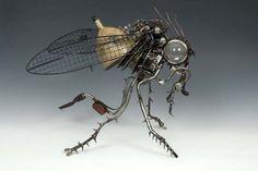 http://geekness.com.br/esculturas-steampunk-feitas-com-pecas-de-carro/