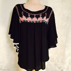 Amazing black peasant top w/embroidery Amazing black top w/beautiful embroidery. Fringe on trim, amazing details. Tops
