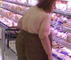 This woman who tucked her tatas into her pants. | 42 People You Won't Believe Actually Exist