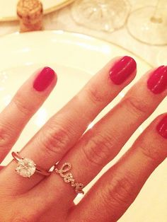 A cute love ring would look good beside my engagement and wedding ring ..