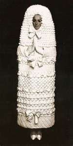 The bride crocheted this dress. Whether she meant to look like a festive penis is yet to be determined.