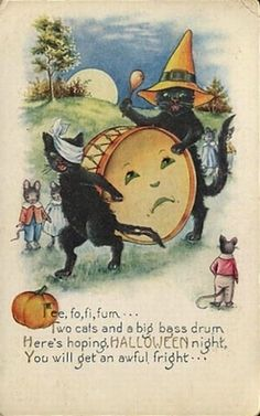 Two Cats and a Big Bass Drum