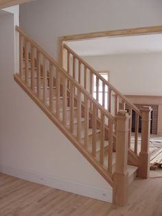 opening up side of stairway | How to transition from stained staircase to painted molding??