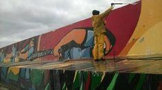 CONSORCIO DE GESTION PUERTO QUEQUEN: COMENZO LA SEGUNDA RESTAURACION DEL MURAL REFLEJOS   Segunda Restauración del Mural Reflejos Comenzó la segunda restauración del Mural Reflejos de la escollera Sur de Puerto Quequén que fuera inaugurada el 6 de diciembre de 2008 y declarado patrimonio cultural de la Nación en 2011. Se estima que la fecha de finalización de la restauración será el 10 de diciembre. El Presidente del Consorcio de Gestión de Puerto Quequén Dr. Arturo Rojas explicó que la…