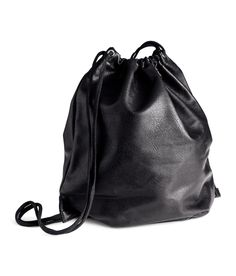 Black faux-leather drawstring backpack.   H&M Accessories