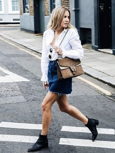 Lucy Williams of #Fashion Me Now has obviously picked up on the #denim miniskirt memo—we like how she's styled hers with a holiday-ready broderie anglaise blouse and winter accessories.