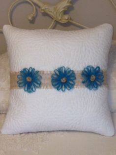 Burlap Pillow Wrap With Flower Embellishments by ASouthernCharmDecor on Etsy https://www.etsy.com/listing/227699453/burlap-pillow-wrap-with-flower