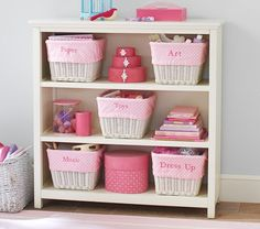 Something like these storage bins. Cameron 3-Shelf Bookcase | Pottery Barn Kids