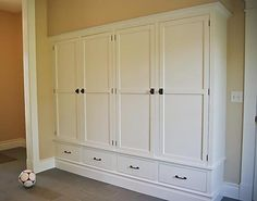 Pantry Idea-instead of the drawers under the cabinet, could do 2 open shelves for shoe storage