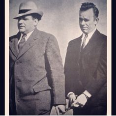 John Dillinger, handcuffed and looking just a little wounded-puppyish. It must have been horrible to be free from jail, only to return (although, granted, he didn't do much to stay out.)