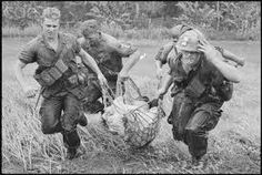 Saigon: Four troopers of the U. Division use a rope hammock to rush a wounded civilian through swampland to a waiting helicopter during fighting 6 miles northwest of dong Tam. Vietnam History, Vietnam War Photos, 7 Marine, Good Morning Vietnam, Rope Hammock, Rich Image, South Vietnam, Vietnam Veterans, American Soldiers