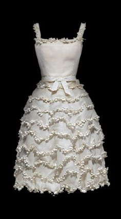 Dior Lily of the valley dress, absolutely nothing to do with North Wales ..just love it. Circa 1954.