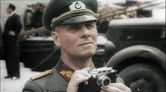 Erwin Rommel, pictured with his Leica III rangefinder camera. Rommel is reported to have been given such a camera by his friend/patron, Joseph Goebbels, before the 1940 Western campaign German Soldiers Ww2, German Army, Erwin Rommel, Afrika Korps, Panzer, Luftwaffe, Military History, Ww2 History, World War Two