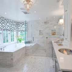 Beautiful transitional white master bath with hammered silver sinks