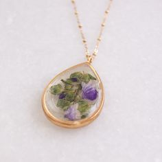 New purple pressed flower necklace is up! Each one has an essential oil diffuser on the clasp!