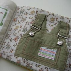 The book is made out of old clothes and teaches a child how to use zippers, buttons, snaps, and hooks on clothing