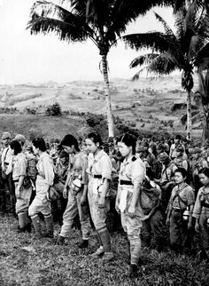 Japanese nurses and soldiers who have surrendered to the Americans just before the Japanese capitulation in 1945.
