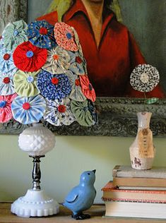 Take an old lamp shade & glue fabric flowers & buttons! duh