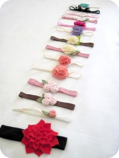 Lots of flower headband tutorials:  the purl bee - felt rose barrette, little miss momma - scrunch fabric flower pom pom tutorial, little birdie secrets - fabric rosebud tutorial, not martha (on holidash) - felt dahlia, i am momma - hear me roar - rolled felt flower