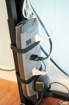 Attach power strip to desk leg with velcro strips to keep loose cords at bay.