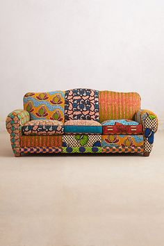 Franco Dutch Wax Sofa by Anthropologie ( I like the shape of this but not the fabrics, nor the price.  I would like it in assorted fabrics: medium floral, pinstripes, solids, etc)