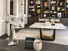 In a study devised by Zana, dramatic black shelving displays artwork.