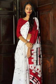 This cotton saree has handcrafted batik print in Red and Black, a tribute to the beautiful jewelry worn by Maasai women in Africa. Great for a morning occasion when worn with silver jewellery.