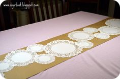 Kraft paper table runner... could possibly have crayons at each table?