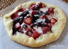 Mixed Berry Galette | Cornmeal in the crust soaks up any juice that runs off the berries in baking, and you can really taste the natural sweetness of the fruit with subtle tart undertones from the yogurt. This is one of those flexible recipes that can be filled with any type of berry or fruit that you like; you could even use fruit jam and omit the sugar.