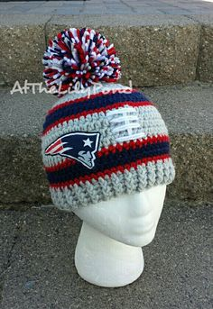 This handmade, New England Patriots Inspired Beanie is great for all fans, big and small! Made with soft yarn for warm and comfortable wear. The emblem is machine sewn on to a soft fleece backing. Sizing based on head circumference; Newborn: 12-13.5 inches 0-3 month: 13.5-15 inches 3-6