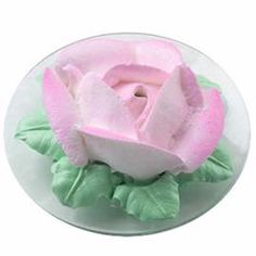 Solitary Rose Mini Cake. Larger-than-life sized rose holds a 3-1/2 in. mini ball cake inside! Graceful petals are piped using whipped topping. Color Mist™ spray adds the subtle variations of pink.
