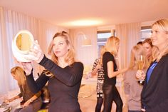 Sandra checking her new look at Kim D's Dianne Brill Beauty Home Party