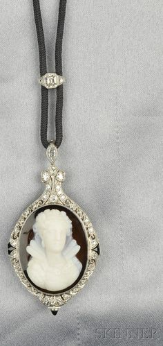 [IMAGE 2] Art Deco Platinum, Hardstone Cameo, and Diamond Pendant Watch, the hardstone cameo depicting an Elizabethan maiden, within an elaborate mount set with old single- and old European-cut diamonds and fancy-cut onyx, millegrain and engraved accents, enclosing a Gruen Watch Co. 16-jewel manual-wind movement, the bail set with two marquise-cut diamonds, and suspended from black cord with an Asscher-cut diamond slide, pendant