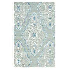 """Add a pop of pattern to your living room or den with this hand-tufted wool rug, showcasing a diamond medallion motif in ivory and blue.  Product: RugConstruction Material: WoolColor: Blue and ivoryFeatures:  Hand-tuftedMade in IndiaPile Height: 0.63""""Note: Please be aware that actual colors may vary from those shown on your screen. Accent rugs may also not show the entire pattern that the corresponding area rugs have.Cleaning and Care: Professional cleaning is recommended. Rug pad required."""