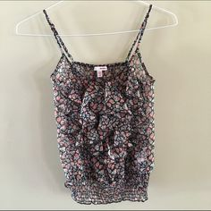 Bongo Floral Top Pretty floral top with ruffle detail in the front. Elastic band on bottom. BONGO Tops Camisoles