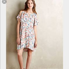 """Anthropologie Maeve Fluttered Watercolor Dress NWT Brand new with tags. Medium. Cold shoulder detail. Swing silhouette. 33.25"""" long from shoulder. Polyester crepe dress/polyester lining. Originally $138 at Anthropologie. Beautiful dress just a little too big for me. Anthropologie Dresses High Low"""