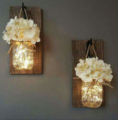 Hanging mason jar sconces made with fairy lights